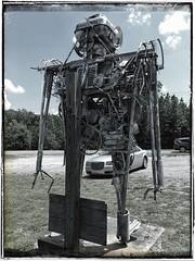 Folk Sculpture | Robot Lirpa-Anad-Nitsud* | Fischer Crossroads | Fort Payne, Alabama | View 3 (steveartist) Tags: sculpture metalsculpture junksculpture folkart outsiderart robot monumentalsculpture mikegoggans thebarnyard fischercrossroads fortpayneal photostevefrenkel woodenpole lirpaanadnitsud iphonese snapseed