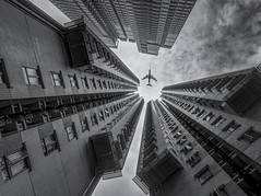 looking up (Wizard CG) Tags: hollywood terrace sheung wan central hong kong skyscraper architecture hdr blackandwhite monochrome epl7 olympus tower b airplane