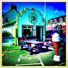 Original colourful Lick'd (Julie (thanks for 9 million views)) Tags: hss sliderssunday 100xthe2019edition 100x2019 image57100 squareformat kilmorequay takeaway fastfood bench wall window advertising colourful ireland irish wexford icecream sign hbm village