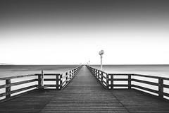 Sunrise Pier (frank_w_aus_l) Tags: natur rügen sonnenaufgang germany bw bnw blackandwhite black nikon df nikkor 2470 longexposure sunrise lamp sky pier symmetry binz mecklenburgvorpommern deutschland