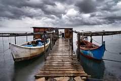 entrance to exit (dim.pagiantzas   photography) Tags: boats smacks bridgwork bridge stall iron plate transportation water waterscape sea seascape seaside sky clouds cloudy reflections rainy atmospheric