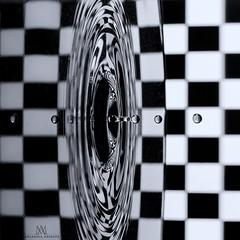 Black Hole (marianna armata) Tags: black blackandwhite mono monochrome greyscale checkerboard reflection water drop macro abstract mariannaarmata