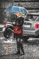 An uncomfortable wait (De Mi Ser) Tags: candid street girl woman city urban rain umbrella