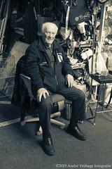 the old market seller (jada photography) Tags: ijmuiden noordholland netherlands beverwijk bazaarmarket bazaar elder sitting person seller chair