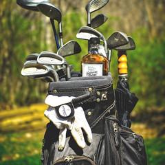 Show Your Bag (Jack Blackstone) Tags: humor kentuckytavern em1mkii golf bag bourbon showyourbag flickrfriday golfbag on1edit bokeh mzuicko25mmf12
