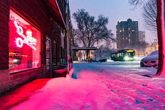 Neon Snow (VBuckley.com) Tags: snow easttown spring blizzard milwaukee milwaukeedowntown wisconsin winter cold evening twilight city lesciseaux neon red magenta bus cityscape nightscape
