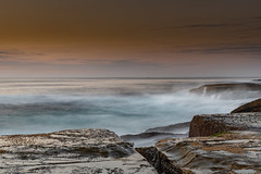 Rock Platform Sunrise Seascape with Light Smattering of Clouds (Merrillie) Tags: daybreak sunrise centralcoast nature dawn terrigal hazy sea morning newsouthwales thehaven rocks earlymorning nsw landscape terrigalhaven ocean sky waterscape rocky coastal australia outdoors seascape waves coast water haven