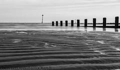 Ripples (Colin Freeman Photography) Tags: beach wales groyne sand rock sea coast landscape wind farm bw black white nikon d750 fx 2470 colwynbay cloud mono timber wood reflection shadow