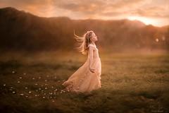 Letting Go ({jessica drossin}) Tags: jessicadrossin girl wind petals flower pink peach sky clouds mountains light dress pretty wwwjessicadrossincom