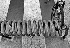 spirals (heinzkren) Tags: schwarzweis blackandwhite monochrome abstract bicycle ricoh grii street zebra zebracrossing spiral bike kickstand stand closed bikelock