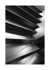 Caixa-Forum Madrid VI (BLANCA GOMEZ) Tags: spain madmadrid bw blackwhite light shadows textures shapes silhouettes urban city arquitectura architecture contemporaryart artecontemporaneo arquitecto herzogdemeuron stairs escaleras caixaforum culturalcentre centrocultural