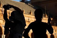 Tablao (1/3) (tresmele) Tags: flamenco sevilla seville plazadeespaña contraluz baile dance andalucia andalusia castañuelas abanico backlight bokeh exterior textura pasión slow black negro marron monumento monument canoneos100d sevillanas lunares lunar moño arco