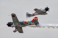 Vultee BT-13A Valiant (Aichi D3A1 Val) and CCF T-6J Harvard IV (Mitsubishi A6M Zero) - 01 (NickJ 1972) Tags: mcas yuma airshow 2019 aviation toratoratora tora vultee bt13 valiant n56478 bi78