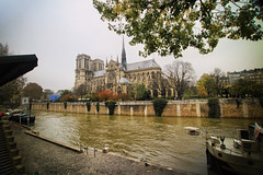 Notre Dame Cathedral from the River Seine in Paris, France (` Toshio ') Tags: toshio paris france notredamecathedral notredame cathedral seine river europe boat church religion iledelacite island canon canon7d riverbank trees