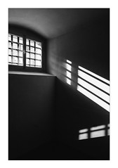 Prison Window (Thomas Listl) Tags: thomaslistl blackandwhite biancoenegro noiretblanc monochrome wall reflection light shadow contrast window mood dark sunlight lines geometry graphical diagonal wideangle 24mm summer hot