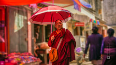 Tibet, candid shot of a monk in the streets of Lhasa (China), 06-2016, 95 (Vlad Meytin, vladsm.com) (Instagram: vlad.meytin) Tags: chengguan china khimporiumco lhasa meytin tibet tibetan vladmeytin asia candid chinese highaltitude local man monk people photography red sony sonya7 sonyalpha street streetlife streetphotography streetscene summer traditionalclothes umbrella vladsm vladsmcom vmwelt walking zeiss བོད་ ལྷ་ས། 中国 中國 拉萨 西藏 peoplesrepublicofchina