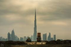 Unsung Hero (Charlie_Joe) Tags: uae dubai burjkhalifa construction architecture clouds worker silhouette cityscape canon mydubai