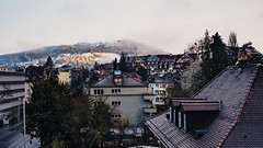 The view from the apartment (VirtualWolf) Tags: bern building canonef35mmf14lusm canoneos5dmarkiv europe landscape snow switzerland trees vintage