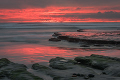 Intense (CloudRipR) Tags: sunset waves ocean rocks tidepool red sand reflection evening clouds california southerncalifornia socal encinitas