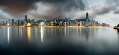 Panorama of Hong Kong City skyline at sunrise. View from across Victoria Harbor HongKong. (MongkolChuewong) Tags: architecture asia background beautiful blue boat building business china chinese city cityscape cruise downtown harbor harbour hong hongkong island junk kong landmark landscape modern night ocean panorama port red sail sailboat sea ship sightseeing skyline skyscraper sunrise sunset tourism tourist tower traditional transportation travel vacation vessel victoria view water wooden
