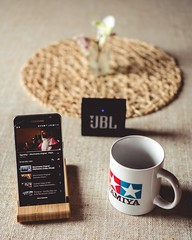 black Samsung smartphone playing video beside white ceramic mug and black JBL Go speaker - Credit to https://myfriendscoffee.com/ (John Beans) Tags: coffee cafe coffeebeans shopbeans espresso coffeecup cup drink cappucino latte