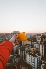 person holding yellow ceramic mug - Credit to https://myfriendscoffee.com/ (John Beans) Tags: coffee cafe coffeebeans shopbeans espresso coffeecup cup drink cappucino latte