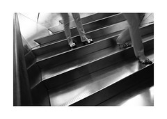 Caixa-Forum VIII (BLANCA GOMEZ) Tags: spain mad madrid bw blackwhite urban city centrocultural culturalcentre caixaforum arquitectura architecture artecontemporaneo contemporaryart arquitecto herzogdemeuron stairs legs shoes escaleras piernas zapatos light shadows textures silhouettes shapes