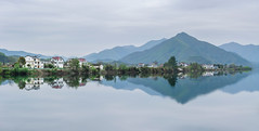 On the trip (Picocoon图茧) Tags: landscape river reflection village nature mountain mirror tranquility anhui taohuatan china chinese building travel trip
