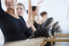Row of ballet dancers practicing at the barre in rehearsal room (BUS idiomas) Tags: active agility armsraised balance ballerina balletdancer barre caucasian dance dancer exercise female flexibility focus grace healthy hobbies horizontal indoors leg people practice practicing rehearsal room row stretching studio women