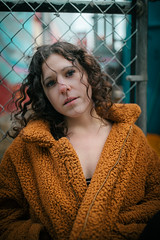 Captured by Ginny Photography (nclem93) Tags: underground ink block boston city canon photo photgraphy portrait fence chain link curly hair wind flowy massachusetts nikon girl