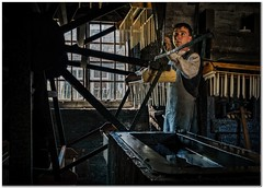 Another day at the candle factory (Hugh Stanton) Tags: factory window machines vat
