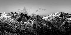 Rocky Mountains of the Alps (série 2/2) (Frédéric Fossard) Tags: monochrome noiretblanc blackandwhite grain texture ciel sky nuage cloud montagne mountain paysage landscape mountainscape neige snow névé glacier altitude horizon mountainpeak mountainrange mountainridge montbuet mountainpass massifdesaiguillesrouges alpes hautesavoie massifdugiffre cimes crêtes arêtes vallon valley vallée massifalpin aiguillesrocheuses massifrocheux