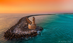 Light House at Livorno (Alfredo Rafael) Tags: sunsets lighthouse harbour livorno italy tuscany historic europe meditarranean sea port colorful jetty shoreline horizon dusk seascape infinitexposure ocean rocks waves water colors stones mar azure view coastal maritime sky orange pisani breathtaking