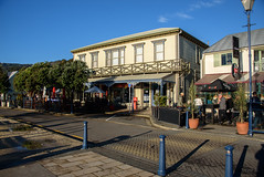 Not Many People About Today (Jocey K) Tags: newzealand bankspeninsular akaroa hills street architecture signs cafes buildings trees shadows