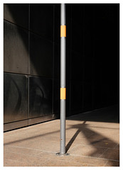 Docklands Pole (Dave Button) Tags: london docklands canarywharf color colour fuji fujifilm xe2 xe2s minimal graphic line lines architecture detail