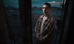In sight of light (1NterSk1llz) Tags: portrait man guy roof evening moscow 5d mark ii sigma 20mm door speedlight look standing spring springtime dark short hair light city urban underground insightoflight