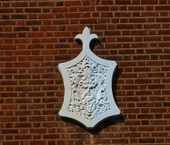 Green Man in white (helenoftheways) Tags: greenman white bricks brown emblem ladywell lewisham uk