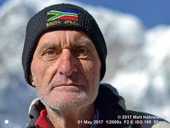 2017-05a Trekking Everest Base Camp (08) (Matt Hahnewald) Tags: primelens street portrait selfportrait depthoffield blue sunlight character photographer travel trekking male posing authentic rugged eyes matthahnewaldphotography face facingtheworld eastnepal elderly everestbasecamptrek gorakshep stubble himalayas horizontal head nikond3100 outdoor lowangle solukhumbu 50mm expression headshot nikkorafs50mmf18g fullfaceview woollencap 1200x900pixels resized colour person 4x3ratio closeup lookingatcamera clarity background