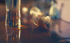 No use crying over spilled beer (charhedman) Tags: brokenbeerglass puddle wateronthetable nousecryingoverspilledmilkorspilledbeer 50mmlens liquid light bokeh 52weekthemechallenge favouritelens