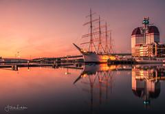 The Viking (Fredrik Lindedal) Tags: viking boat harbor gothenburg göteborg göteborgshamn city cityscape sunset reflection reflections building bridge ship boats sky skyline lindedal sweden sverige