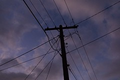 Power Pole During Last Light (HaskelR) Tags: cable clouds engineering light line linear pole power silhouette sky
