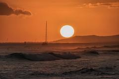 Surfing at Sunset (Fletch in HI) Tags: nikon d5600 tamron 16300 hoyaredintensifierfilter honolulu hawaii magicisland alamoana water ocean oahu sunset surfers boats people clouds