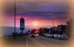 Sunset (Rollingstone1) Tags: helensburgh scotland westdunbartonshire sunset spring urban street road cars hills sign people lamppost colour vivid art artwork