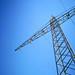 Power line against a deep blue sky