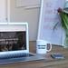 MacBook Air beside cup - Credit to https://myfriendscoffee.com/