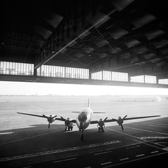 Skymaster (csobie) Tags: bronicasqa 50mmf35s ilford fp4 film analog mediumformat scan epson v600 berlin germany tempelhoferfeld blackandwhite square 120 6x6 skymaster aircraft airport