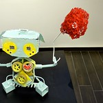 Kid Robot (Steel, chicken wire, led lights, sensors, rubber toy tires, acrylic paint and hot glue), by Marcela Estrada thumbnail
