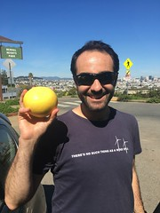 Seth and a grapefruit (olive witch) Tags: 2019 abeerhoque bayarea day fruit male mar19 march outdoors park sanfrancisco sf street