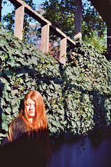 Mathilde. (Nicolas Fourny photographie) Tags: canon eos3 50mm model beauty redhead redhair romanticism naturallight spring garden trees portrait portraiture womanportrait girlportrait beautifulgirl beautifulwoman dof depthoffield kodak ektar100 analogcamera analogphotography 35mm film filmisnotdead shadows
