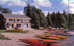 Loch Insh, 1975 (M McBey) Tags: scotland loch insh watersports lake canoe building recreation trees clouds